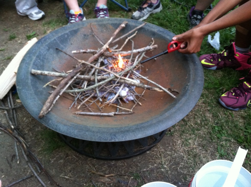 Teaching my Girl Scout troop how to properly build a campfire.