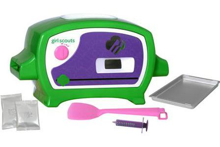 The Girl Scout Cookie Oven includes everything you see here, iincluding a package of Thin Mint Cookie mix.
