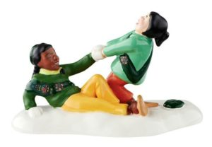 This Girl Scout figurine shows the sisterhood between fellow scouts when they are out playing in the snow.