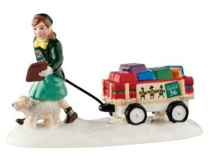 A fun gift to give your favorite Girl Scout-a figurine of a scout selling cookies.