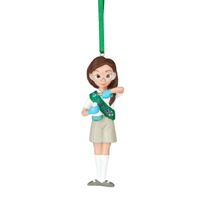 This Junior Girl Scout Christmas ornament features a young girl wearing science goggles and doing an experiment.