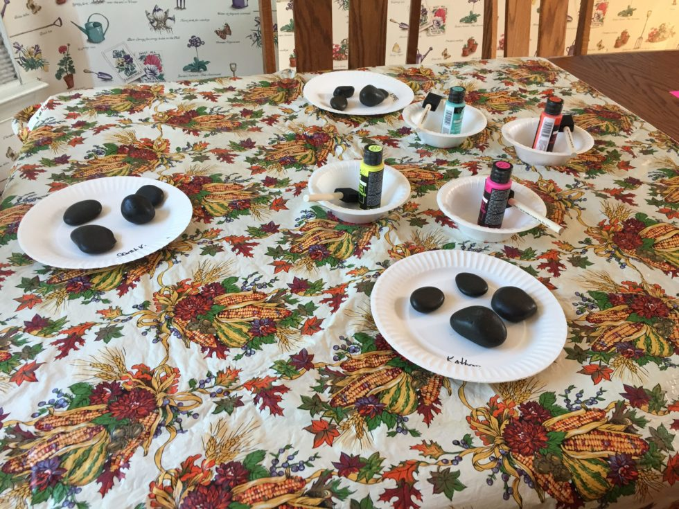 For the Senior Girl Scout Journey Mission:Sisterhood, my troop painted river rocks and wrote messages on them to hand to friends when they needed to know that someone cared.