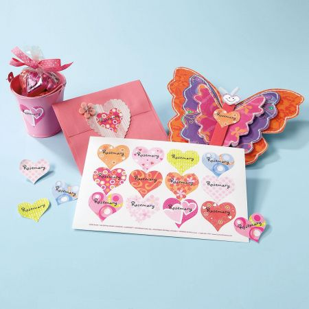 "These heart stickers can be personalized with a girl's name or with a saying like ""I lLove Girl Scouts""."